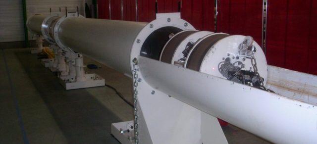 Robot pousseur avec coussins gonflables ou vérins souples pour déchets nucléaires